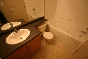 An example of a full bathroom in an apartment style condo in Eaux Claires, Edmonton