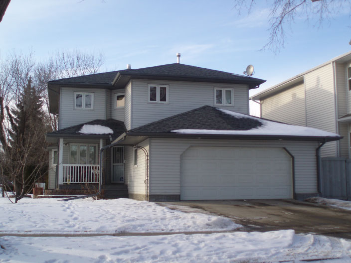 Two-storey infill home with attached garage in Westmount, Edmonton