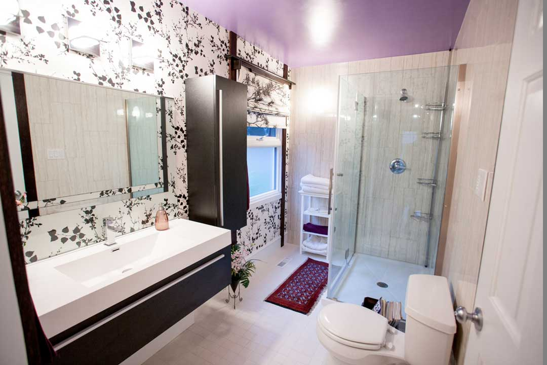 3 becomes 4. A double sink and jetted tub are exchanged for a single sink and frameless shower
